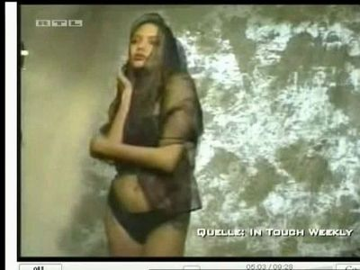 Angelina Jolie posing in sexy dress on TV
