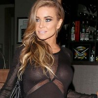 Heart pounding images of sexy Carmen Electra and her nipples!