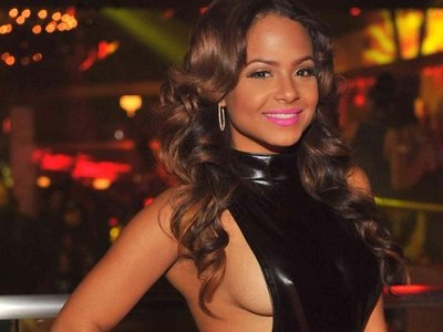Amazing Christina Milian in a hot boob flashing dress!