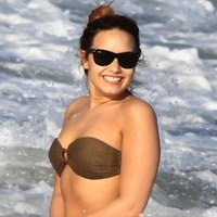 Demi Lovato caught in the sea surf