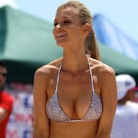 Joanna Krupa plays beach volleyball in casual clothes