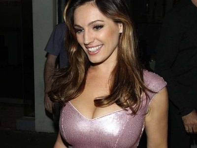 Busty Kelly Brook in a tight dress