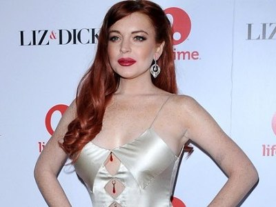 Redhead Lindsay Lohan on a red carpet