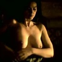 Monica Bellucci showing boobs and teasing in 'Malena'